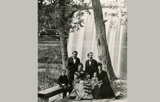 Photograph of William H Illingworth (left) with a group at Minnehaha falls c.1865.