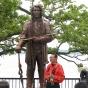 Ojibwe spiritual Leader Larry Aitken with Shaynowishkung statue