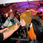 Kissing an eelpout for luck at the International Eelpout Festival, Walker, 2013. Photo by Josh Stokes.