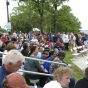 Crowd at dedication of third Shaynowishkung statue