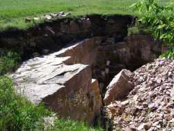 Color image of a pipe quarry pit, Pipestone National Monument, 2009. Photograph by the National Park Service.