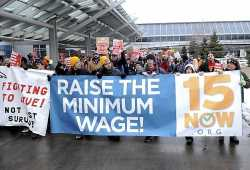 : Demonstration, led by 15 Now Minnesota, for higher pay and better working conditions at the Minneapolis-St. Paul International Airport, December 2014. Used with the permission of 15 Now Minnesota; photographer unknown. Photograph by Ginger Jentzen; used with the permission of Ginger Jentzen.