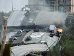 View of the collapsed I-35W bridge (Bridge 9340) on August 1, 2007. Photograph by Heather Munro.