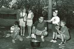 Black and white photograph of campers cooking outdoors at Dick Butwin Day Camp, 1967.