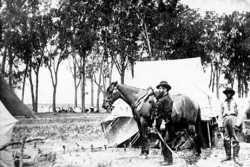 Black and white photograph of Major Brackett and his aide, Van Garren, at a camp in Dakota Territory, 1864.