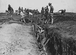 Black and white photograph of officers-in-training building a trench at Fort Snelling, 1917.