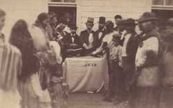 Black and white photograph of annuities being paid at the Fond Du Lac reservation, c.1865.