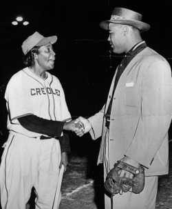 Black and white photograph of Toni Stone meeting her idol, boxer Joe Louis, c.1949.