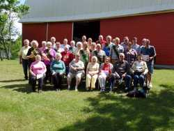 Color image of a Minnesota State Grange picnic held on the Sletton Farm in Aitkin on June 13, 2015.