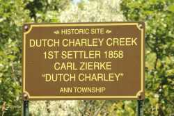 Color image of a commemorative sign erected in 1949 to mark the site of the Zierke family cabin, ca. 2010. Photograph by Dave Van Loh.