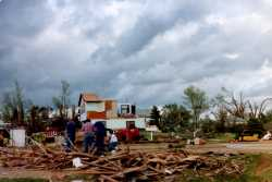 Survivors of the Chandler–Lake Wilson Tornado inspect damaged property in the aftermath of the storm, June 1992.