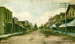 Colorized tinted photographic postcard showing Lewis Street in Watertown, c.1909.