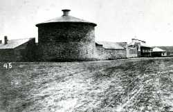 Black and white photograph of an exterior view of Fort Snelling showing the Round Tower, 1863.