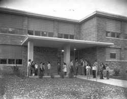 Black and white photograph of the exterior of the Minneapolis Talmud Torah at 1616 Queen Avenue North in Minneapolis, 1951. Photograph by the Minneapolis Star Journal Tribune.