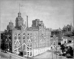 A view of Hamm's Brewery in St. Paul, designed by August Maritzen, ca. 1905. The ornamental design of the building was later removed as the facilities were updated for operations. The large house on the bluff near the brewery was built for Theodore Hamm and his wife, Louise.