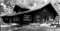 Black and white photograph of the Marcell Ranger Station, c.1994.