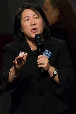 Color image of Minnesota state senator Mee Moua speaks at a rally on October 30, 2008, in support of Barack Obama, Al Franken, and other Democratic candidates.