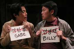 Color image of Gabe (Michael Sung-Ho) and Billy (Eric Sharp) in the Mu Performing Arts production of Middle Brother, written by Eric Sharp and directed by Robert Rosen, 2014. Michal Daniel, photographer.