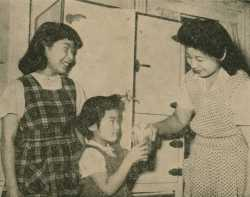 Mrs. Thomas Yamazaki with her daughters Luanne (left) and Aveline (right) at the St. Paul Resettlement Hostel