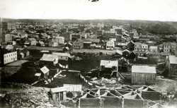 Black-and-white photo print of downtown St. Paul in 1857.