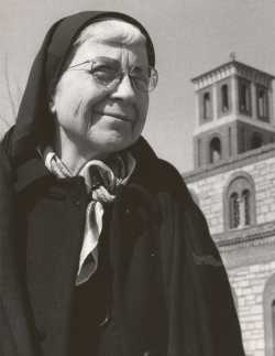 Black and white photograph of Alice Gustava Smith (Sister Maris Stella) at Our Lady of Victory Chapel on the campus of the College of St. Catherine, c.1970.