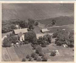 Black and white photograph of the Wiens family homestead, ca. 1950s