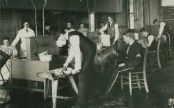 Black and white photograph of a butter-making class, University of Minnesota School of Agriculture, 1889.