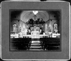 photograph of the altar and main aisle of St. Peter Claver