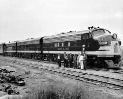 George E. Mackinnon with train crew
