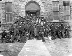 Children on the steps of the Indian School at Pipestone