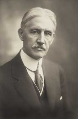 Black and white photograph of Clarence Johnston, ca. 1919.