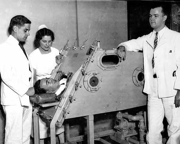 Iron lung patient and staff, Sister Kenny Institute, Minneapolis.