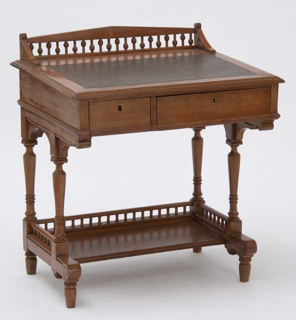 Color image of a small maple sloping lid desk used by the Minnesota state Legislature, ca. 1882.
