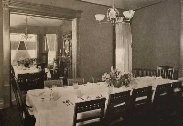 Black and white photograph of the dining rooms of Graham Hall, ca. 1908.