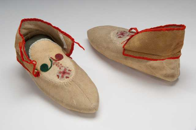 "Color image of Dakota beaded and ribbonwork moccasins, made by Sarah Good Thunder (Dakota), 1904. Inscribed: ""Made by Mrs. Good Thunder for Mrs. Whipple 1904."""