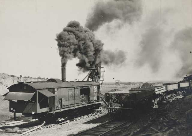 Oliver Mining Company steam-powered shovel near Hibbing, 1919. A shovel removes overburden, the rock and soil that covers the ore body, so that miners can access the ore from the open pit.