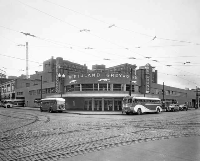 Black and white photograph of the Greyhound Bus Depot, located at First Avenue North and Seventh Street, Minneapolis, ca. 1935. Photograph by Charles W. Howson Company.