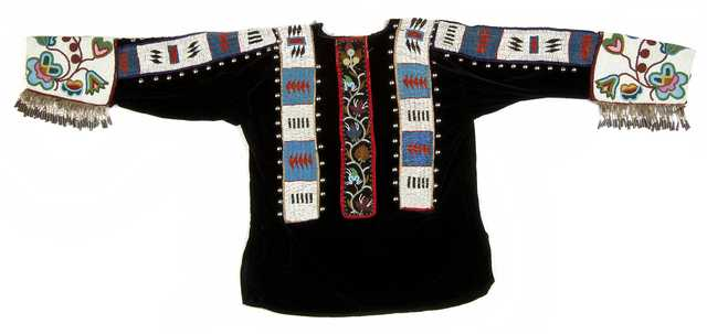 Ojibwe black velvet dance costume shirt was probably made for Kay-zhe-baush-kung (Otto Bismark) of Walker, Minnesota. Purchased by Neal Barnard at the Leech Lake Reservation ca.1920.