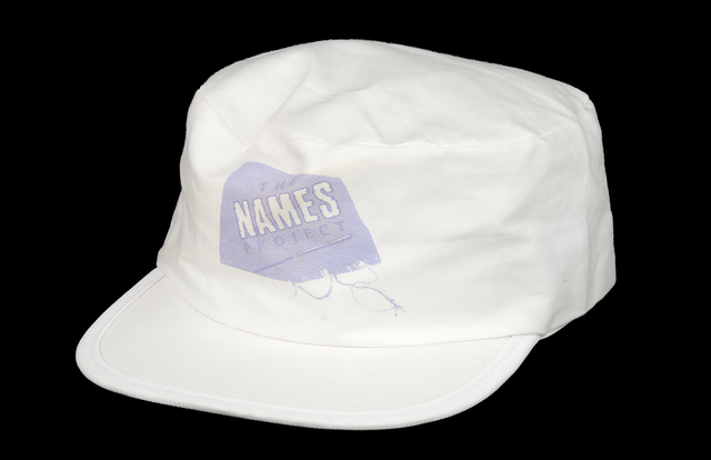 Color image of a hat given to volunteers at the NAMES Project tour stop in Minneapolis, Minnesota, 1988.