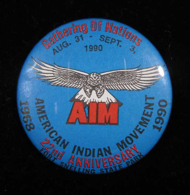 Round pinback button commemorating the twenty-second anniversary of the American Indian Movement (AIM). Manufacturer unknown, circa 1990.