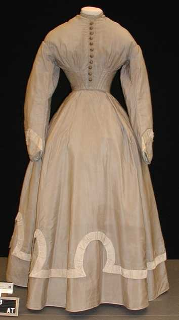 Color image of a wool wedding dress and jacket worn by Mary T. Hill, 1867.