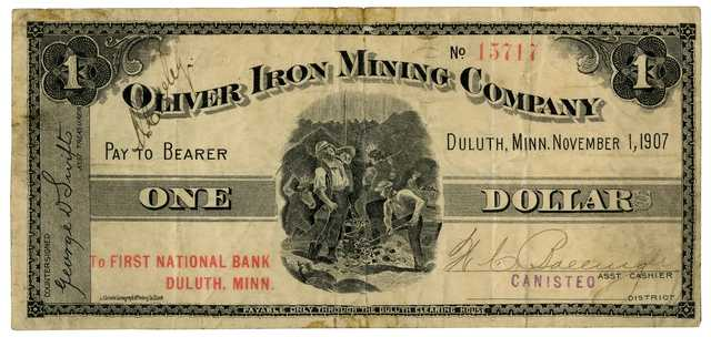Oliver Mining Company $1.00 scrip note. This note was used as currency in the communities near the mines that OMC operated. The bill features an image of miners working in a mine, and the bill was issued in the Canisteo District in 1907.