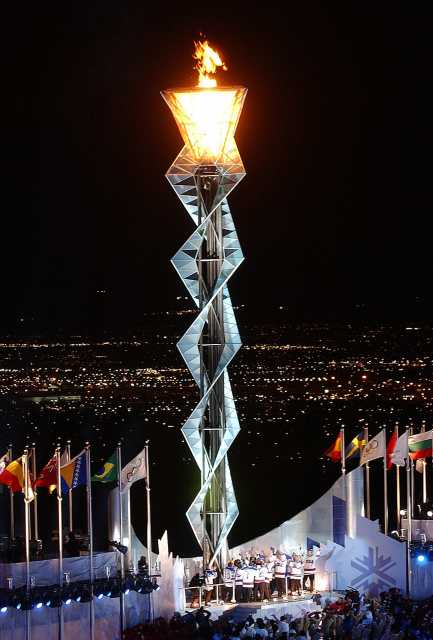 Color image of the 1980 Olympic U.S. Hockey team lighting the cauldron at the 2002 Olympics in Salt Lake City, Utah. Photographed by Preston Keres on February 8, 2002.