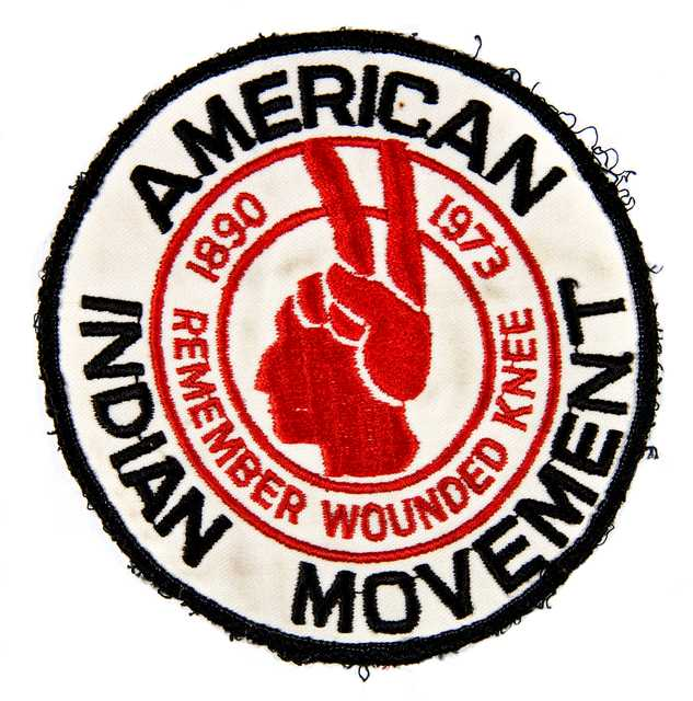American Indian Movement (AIM) patch commemorating the eighty-third anniversary of the Wounded Knee massacre in South Dakota, 1973.