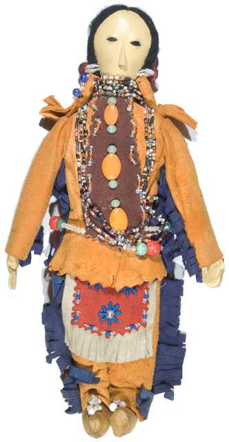 "Color image of a Dakota doll made for ""Bloom Bro. Co. Quality Line Souvenirs, Minneapolis"" by the Bluecloud family from the Upper Sioux Indian Community in Granite Falls in the early 1900s."