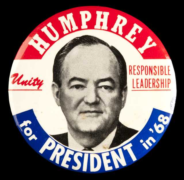 Color image of a pin-back button used during Hubert Humphrey's 1968 presidential campaign.