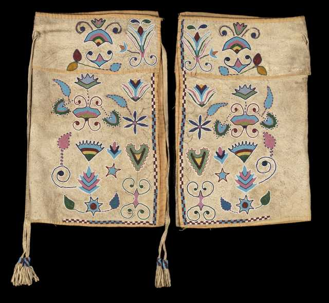 Color image of a pair of beaded Dakota-Metis half leggings, probably from the Red River region of North Dakota, Minnesota, and Manitoba, made in the mid 1800s