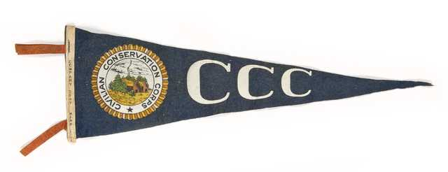 """Color image of a Civilian Conservation Corps pennant owned by Fred Fretheim, ca. 1936–1937. Hand printed on the hoist edge is """"company 2707/Minn/1936-7."""""""