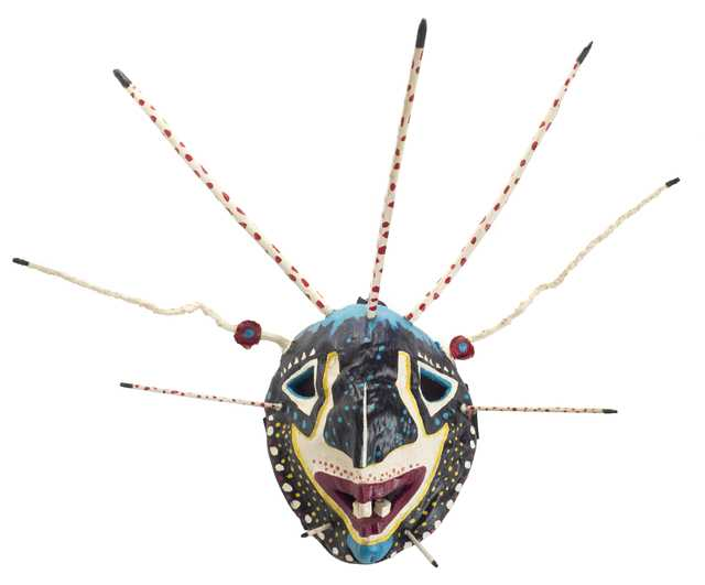 Color image of a carved coconut-shell vejigante mask made by Puerto Rican-Minnesotan artist and musician Ricardo Gómez c.1995.