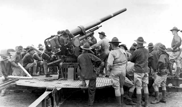 Black and white photograph of soldiers of the newly formed 215th Coast Artillery Regiment at Camp Ripley, 1940.